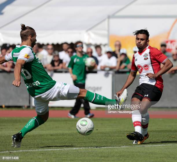 Peter Tschernegg from St Gallen and Sofiane Boufal from FC Southampton in action during the preseason friendly match between FC Southampton and St...