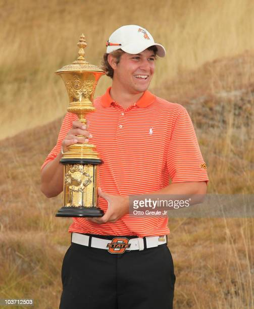 Peter Uihlein holds the Havemeyer Trophy on the final day of the US Amateur Golf Championship on August 29 2010 at Chambers Bay in University Place...