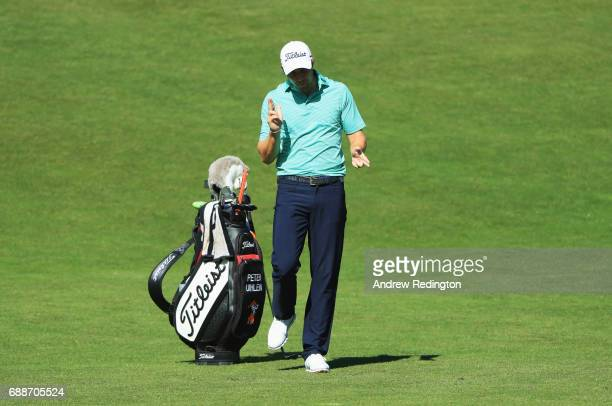 Peter Uihlein of the United States dances in celebration as he scores an eagle on the 7th hole during day two of the BMW PGA Championship at...