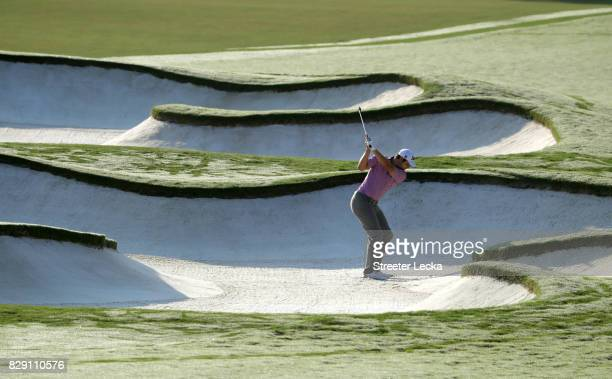 Peter Uihlein of the United States plays his shot out of the bunker on the fifth hole during the first round of the 2017 PGA Championship at Quail...