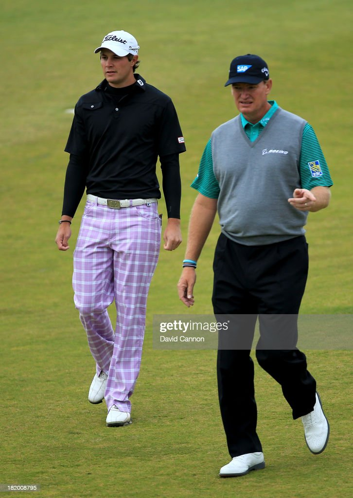 <a gi-track='captionPersonalityLinkClicked' href=/galleries/search?phrase=Peter+Uihlein&family=editorial&specificpeople=5511785 ng-click='$event.stopPropagation()'>Peter Uihlein</a> of the United States (L) with <a gi-track='captionPersonalityLinkClicked' href=/galleries/search?phrase=Ernie+Els&family=editorial&specificpeople=162688 ng-click='$event.stopPropagation()'>Ernie Els</a> of South Africa walking down the fairway before playing their second shots at the par 4, 10th hole during the second round of the 2013 Alfred Dunhill Links Championship at the Kingsbarns Golf Links on September 27, 2013 in Kingsbarns, Scotland.