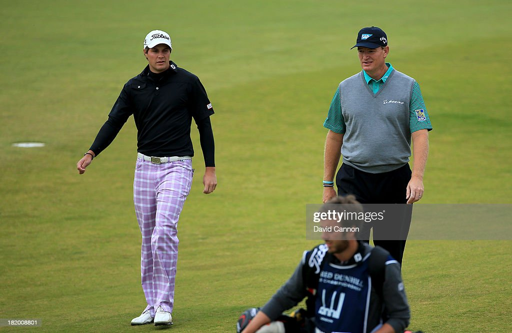 Peter Uihlein of the United States (L) with Ernie Els of South Africa walking down the fairway before playing their second shots at the par 4, 10th hole during the second round of the 2013 Alfred Dunhill Links Championship at the Kingsbarns Golf Links on September 27, 2013 in Kingsbarns, Scotland.