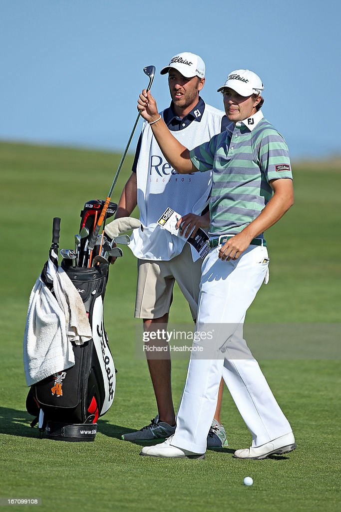 Peter Uihlein of the USA selects a club from his bag on the 18th fairway during the Third round of the Open de Espana at Parador de El Saler on April 20, 2013 in Valencia, Spain