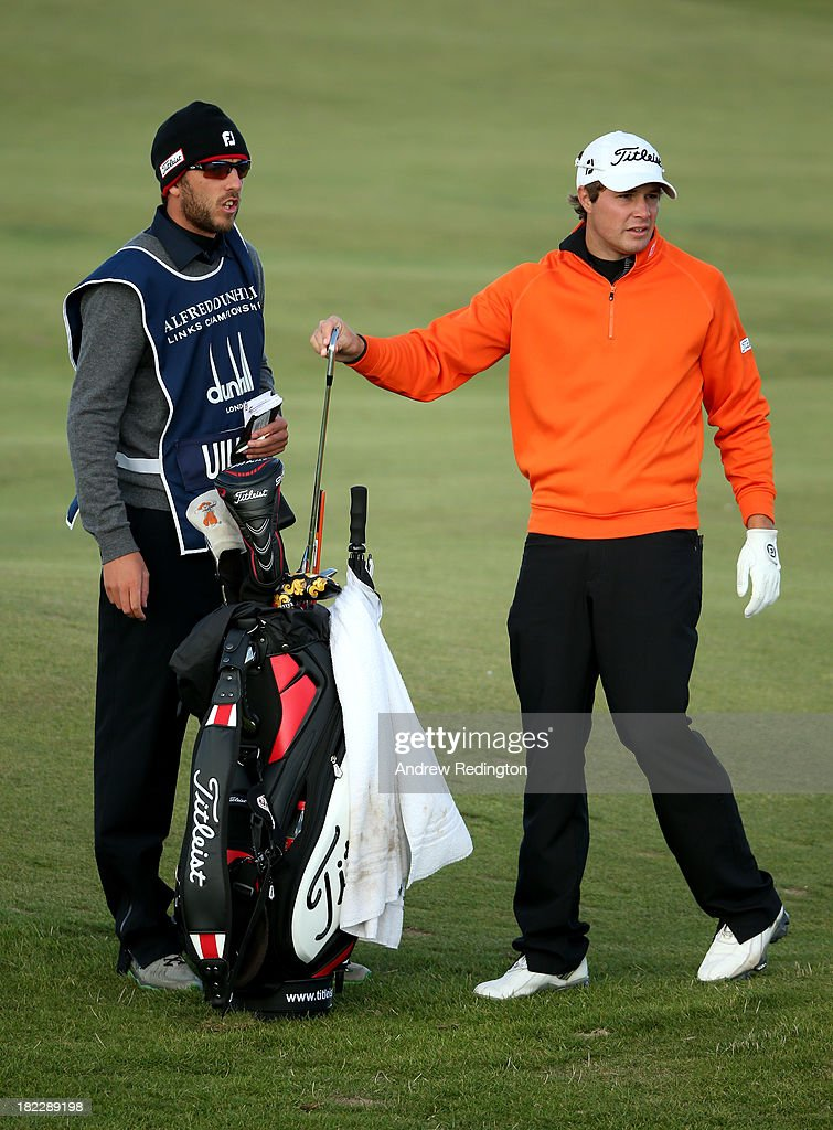 Peter Uihlein of the USA with caddy on the 17th hole during the final round of the Alfred Dunhill Links Championship on The Old Course, at St Andrews on September 29, 2013 in St Andrews, Scotland.