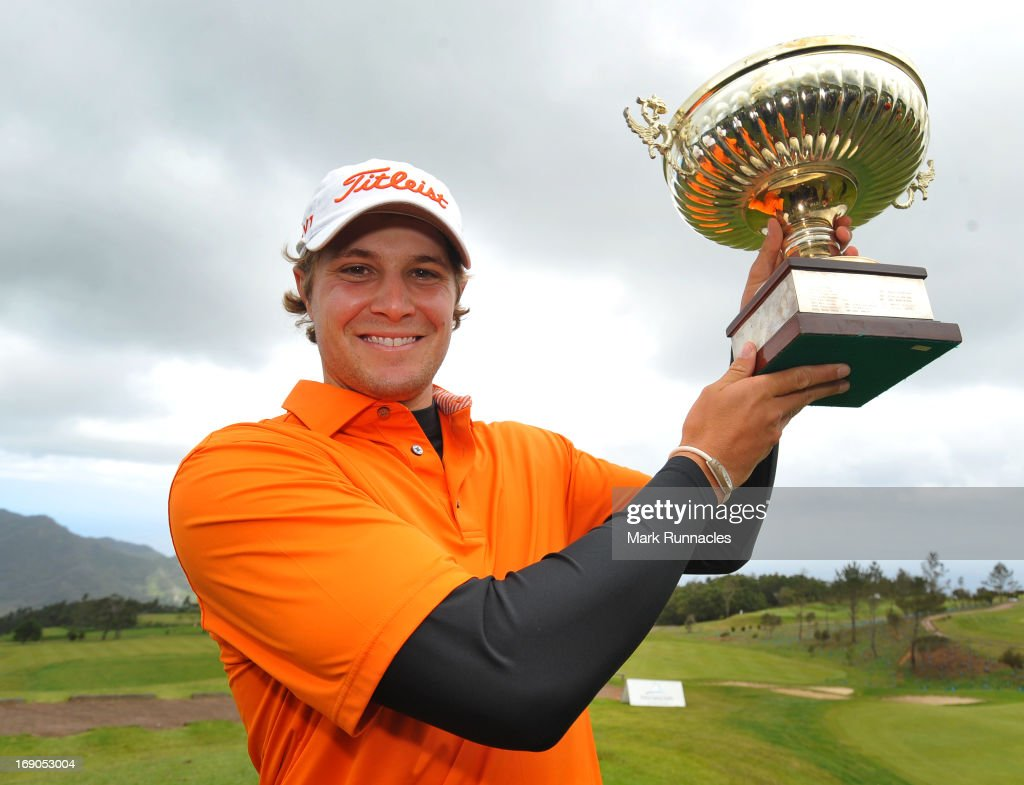 <a gi-track='captionPersonalityLinkClicked' href=/galleries/search?phrase=Peter+Uihlein&family=editorial&specificpeople=5511785 ng-click='$event.stopPropagation()'>Peter Uihlein</a> of USA poses with the trophy after winning the Madeira Islands Open - Portugal - BPI at Club de Golf do Santo da Serra on May 19, 2013 in Funchal, Madeira, Portugal.