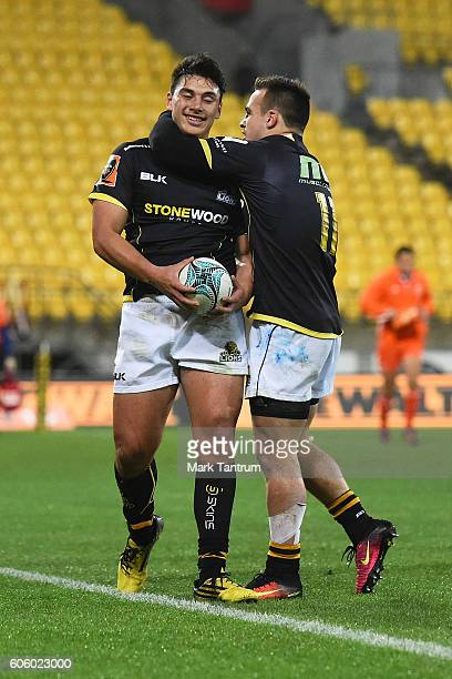 Peter UmagaJensen of Wellington Lions gets congratulated by Wes Goosen of Wellington Lions during the Mitre 10 Cup round five match between...