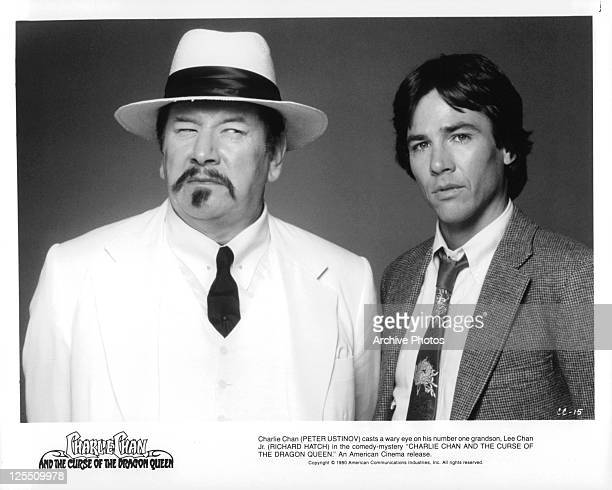 Peter Ustinov And Richard Hatch stand together in a scene from the film 'The Curse Of The Dragon Queen' 1981