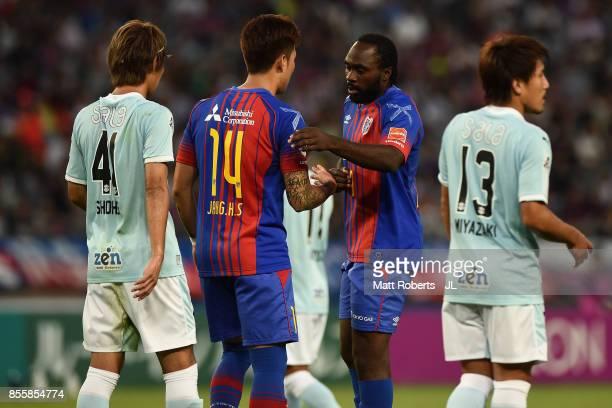 Peter Utaka and Jang Hyun Soo of FC Tokyo shake hands during the JLeague J1 match between FC Tokyo and Jubilo Iwata at Ajinomoto Stadium on September...