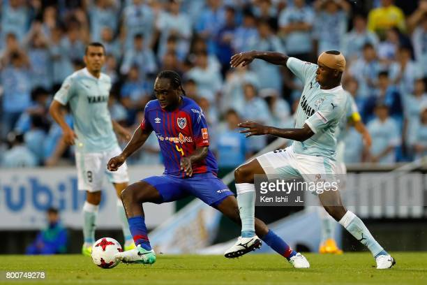 Peter Utaka of FC Tokyo and Adailton of Jubilo Iwata compete for the ball during the JLeague J1 match between Jubilo Iwata and FC Tokyo at Yamaha...