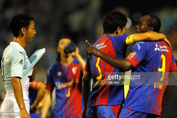 Peter Utaka of FC Tokyo argues with Hayao Kawabe of Jubilo Iwata during the JLeague J1 match between Jubilo Iwata and FC Tokyo at Yamaha Stadium on...