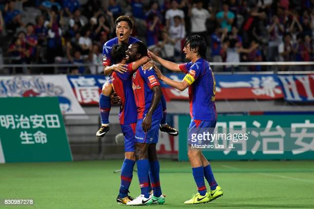 Peter Utaka of FC Tokyo celebrates scoring the opening goal with his team mates during the JLeague J1 match between FC Tokyo and Vissel Kobe at...