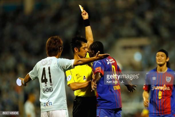 Peter Utaka of FC Tokyo is shown a yellow card by referee Yudai Yamamoto during the JLeague J1 match between Jubilo Iwata and FC Tokyo at Yamaha...