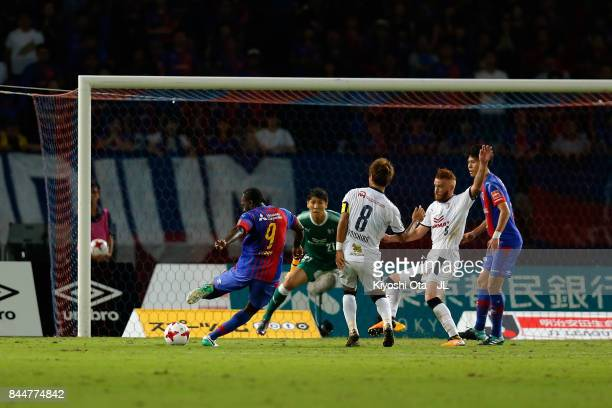 Peter Utaka of FC Tokyo scores his side's first goal during the JLeague J1 match between FC Tokyo and Cerezo Osaka at Ajinomoto Stadium on September...