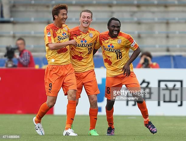 Peter Utaka of Shimizu SPulse celebrates scoring his team's third goal with his team mates Shun Nagasawa and Mitchell Duke during the JLeague match...