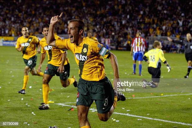 Peter Vagenas of the Los Angeles Galaxy celebrates with teammates after the game with the CD Chivas USA at the inaugural Honda Super Clasico the...