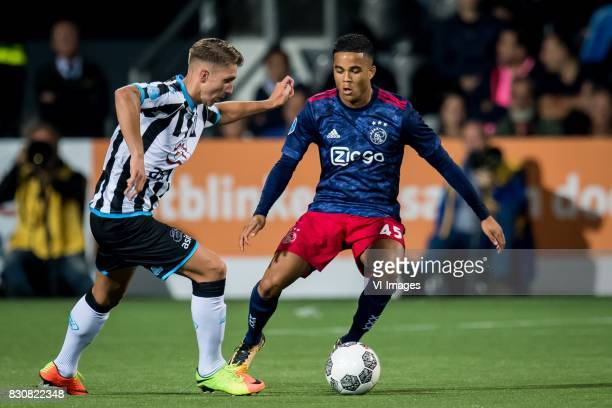 Peter van Ooijen of Heracles Almelo Justin Kluivert of Ajax during the Dutch Eredivisie match between Heracles Almelo and Ajax Amsterdam at Polman...