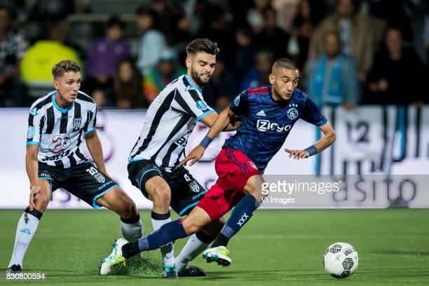 Peter van Ooijen of Heracles Almelo Robin Propper of Heracles Almelo Hakim Ziyech of Ajax during the Dutch Eredivisie match between Heracles Almelo...