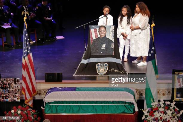 Peter Vega and his sisters Genesis Villella right and twin Delilah Vega children of New York City Police Officer Miosotis Familia participate during...