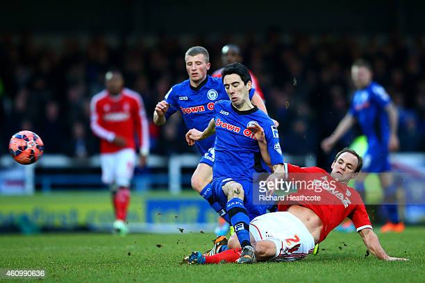 Peter Vincenti of Rochdale battles for the ball with David Vaughan of Nottingham Forest during the FA Cup Third Round match between Rochdale and...