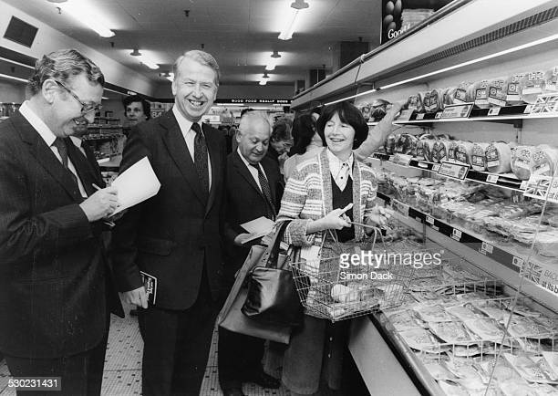 Peter Walker Minister of Agriculture enjoying a joke with housewife Kate Cooke and Sir John Sainsbury promoting 'Eat British Bacon' in a Sainsbury's...