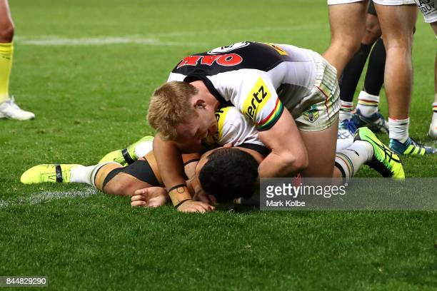 Peter Wallace and Waqa Blake of the Panthers celebrate a try during the NRL Elimination Final match between the Manly Sea Eagles and the Penrith...