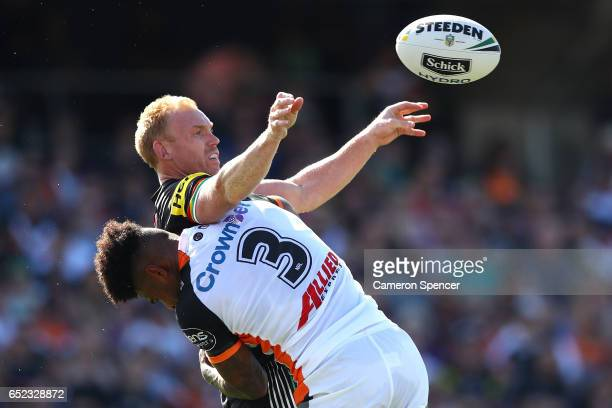 Peter Wallace of the Panthers offloads the ball in a tackle during the round two NRL match between the Wests Tigers and the Penrith Panthers at...