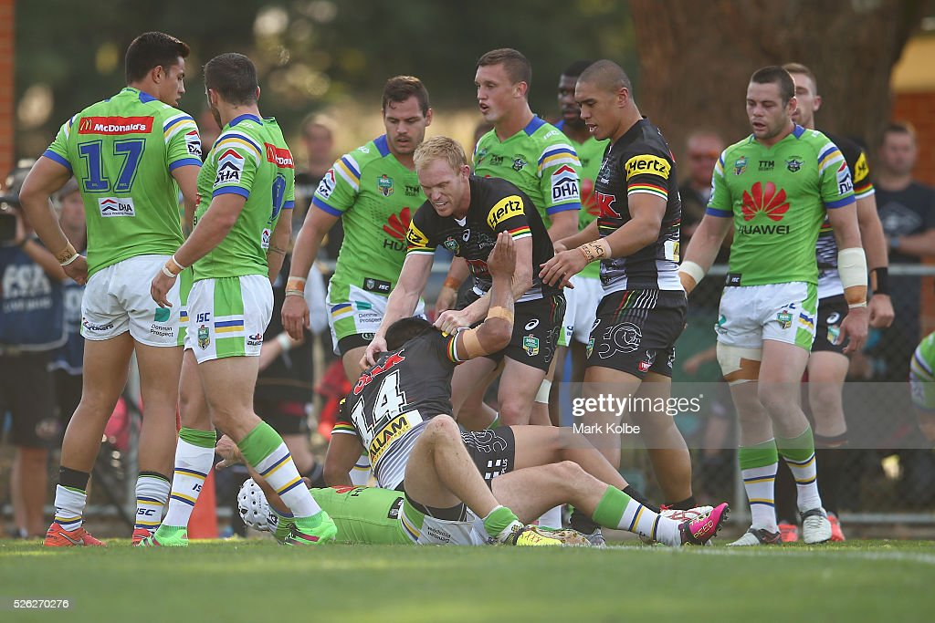 Peter Wallace of the Panthers picks up Tyrone Peachey of the Panthers after he scored a try during the round nine NRL match between the Penrith Panthers and the Canberra Raiders at Carrington Park on April 30, 2016 in Bathurst, Australia.