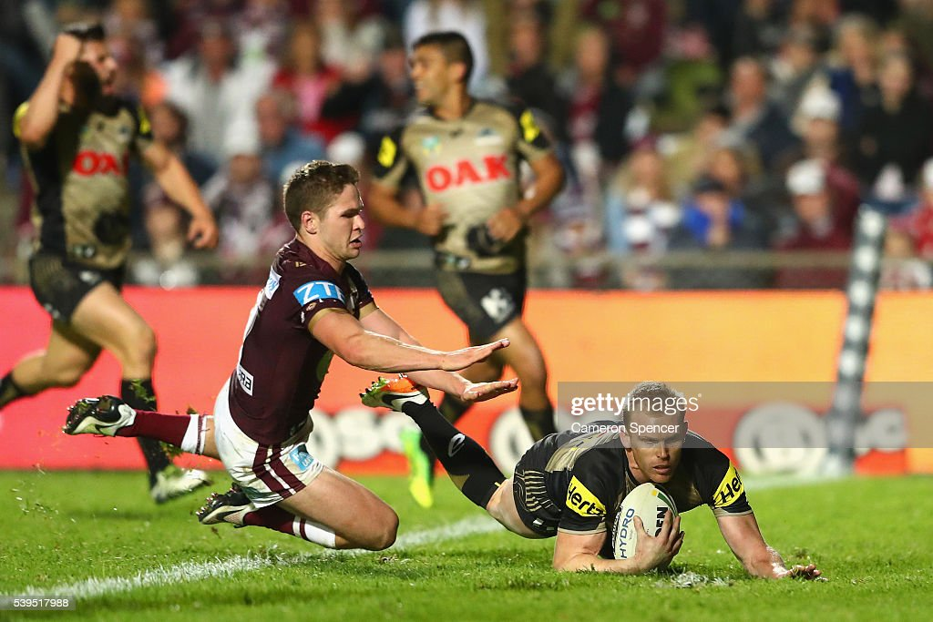 Peter Wallace of the Panthers scores a try during the round 14 NRL match between the Manly Sea Eagles and the Penrith Panthers at Brookvale Oval on June 12, 2016 in Sydney, Australia.