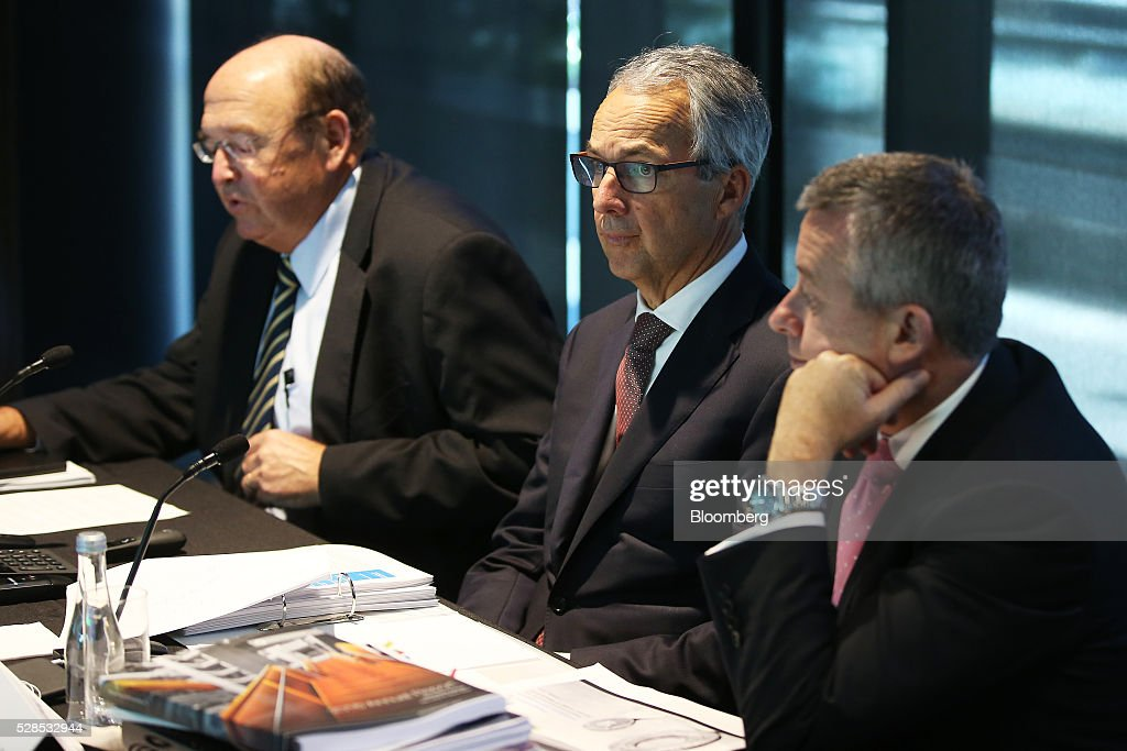 Peter Warne, chairman of Macquarie Group Ltd., left, speaks as Nicholas Moore, chief executive officer and managing director, center, and Patrick Upfold, chief financial officer, look on during a news conference in Sydney, Australia, on Friday, May 6, 2016. Macquarie said full-year profit climbed 29 percent to a record as it flagged lower performance fees from its funds-management unit and signaled that subdued markets may weigh on current-year earnings. Photographer: Brendon Thorne/Bloomberg via Getty Images