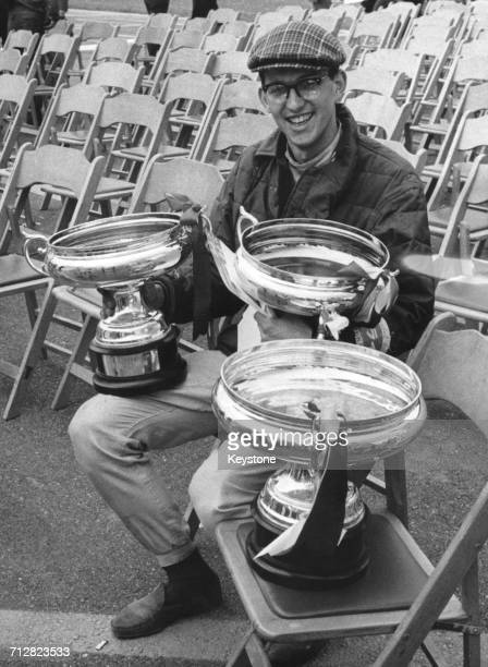 Peter Warr of Great Britain and driver of the Lotus 23B Ford celebrates with the trophies after winning the first Japanese Grand Prix for sports cars...