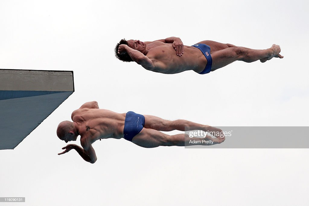 Peter Waterfield (L) and <a gi-track='captionPersonalityLinkClicked' href=/galleries/search?phrase=Tom+Daley+-+Diver&family=editorial&specificpeople=2652461 ng-click='$event.stopPropagation()'>Tom Daley</a> of Great Britain compete in the Men's 10m Platform Synchro preliminary round during Day Two of the 14th FINA World Championships at the Oriental Sports Center on July 17, 2011 in Shanghai, China.
