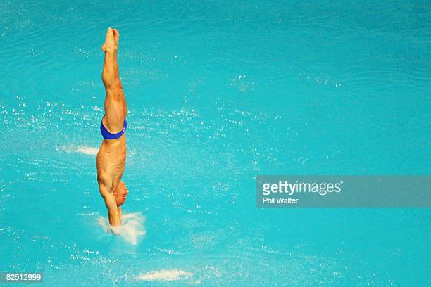 Peter Waterfield of Great Britain competes in the Men's 10m Platform Preliminary diving event at the National Aquatics Center on Day 14 of the...