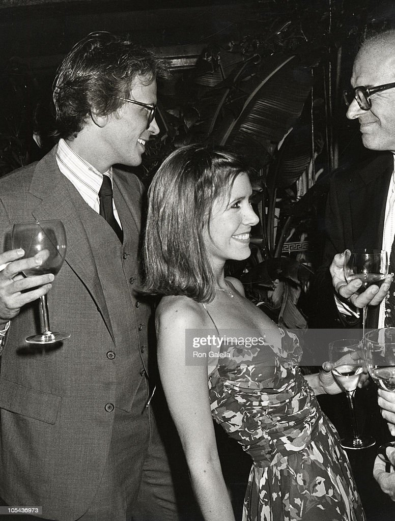 Peter Weller and Carrie Fisher during Giorgio Armani Fashion Show - September 19, 1980 at RCA Promenade in New York City, New York, United States.