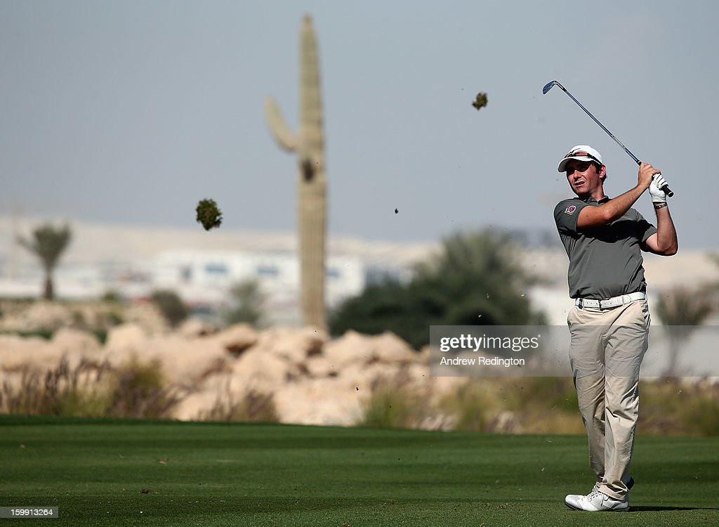 Peter Whiteford of Scotland hits his third shot on the ninth hole during the first round of the Commercial Bank Qatar Masters held at Doha Golf Club on January 23, 2013 in Doha, Qatar.