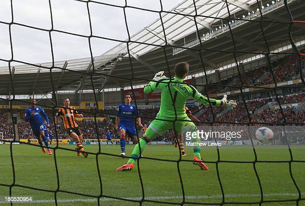 Peter Whittingham of Cardiff City shoots past goalkeeper Allan McGregor of Hull City to score their first goal during the Barclays Premier League...
