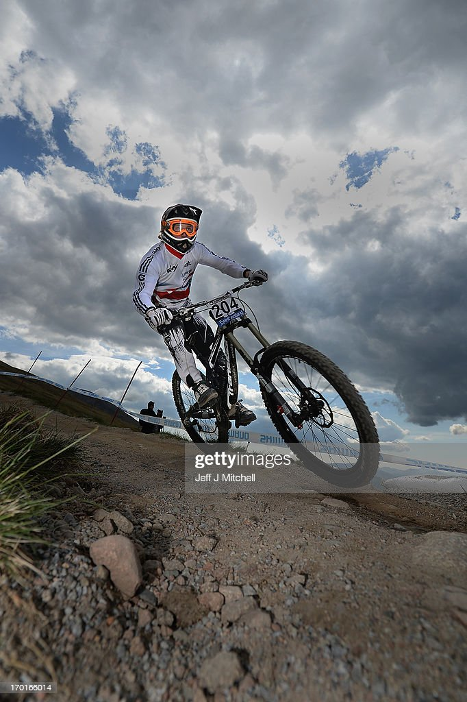 Peter Williams of Great Britain competes in the men's downhill qualifying round at the UCI Mountain Bike World Cup on June 8, 2013 in Fort William, Scotland.