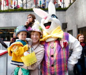 Peter Wolf Jackie Wolf and the Easter Bunny pose for a photo at The Rink at Rockefeller Center on Easter Sunday on April 20 2014 in New York City