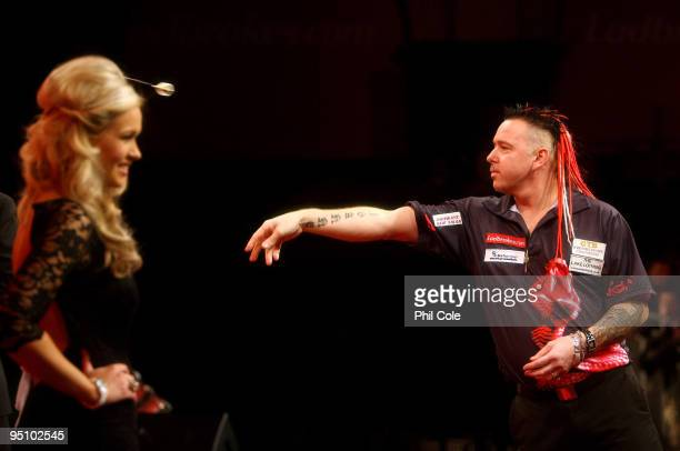 Peter Wright of England in action against Michael van Gerwen of the Netherlands during the 2010 Ladbrokescom World Darts Championship Round One at...