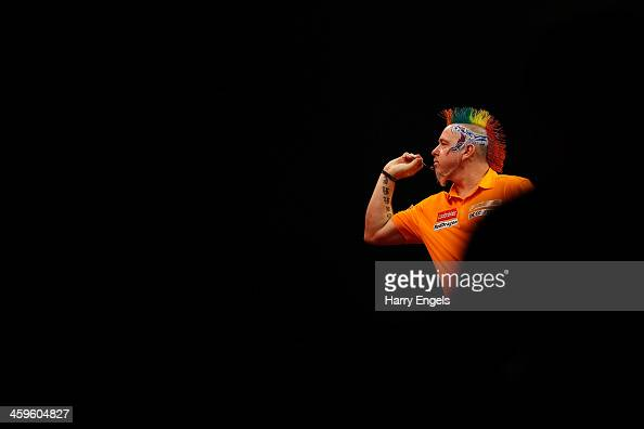 Peter Wright of England in action during his quarter final match against Wes Newton of England on day thirteen of the Ladbrokescom World Darts...