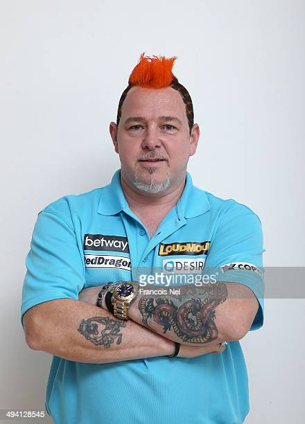 Peter Wright of England poses for a portrait prior to the start of the draw ceremony for the Dubai Duty Free Darts Masters to reveal the Quarter...