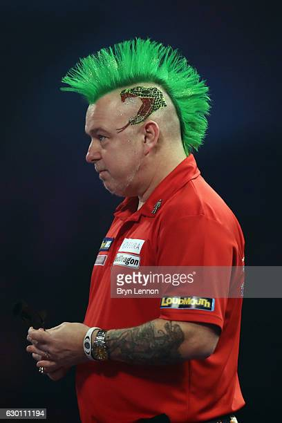 Peter Wright of Great Britain looks on during his game against Jerry Hendriks of The Netherlands on day two of the 2017 William Hill PDC World Darts...