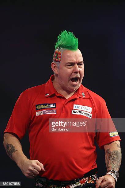 Peter Wright of Great Britain reacts during his game against Jerry Hendriks of The Netherlands on day two of the 2017 William Hill PDC World Darts...