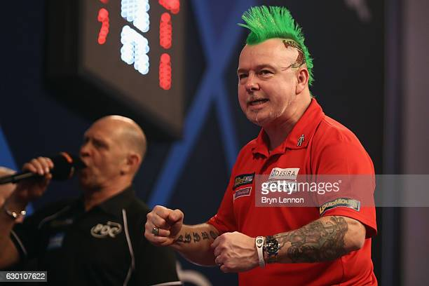 Peter Wright of Great Britain reacts to winning his game against Jerry Hendriks of The Netherlands on day two of the 2017 William Hill PDC World...