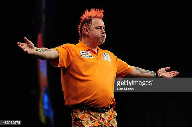 Peter Wright of Scotland celebrates winning a leg against Michael van Gerwen of Holland during The Betway Premier League Darts at Westpoint Arena on...