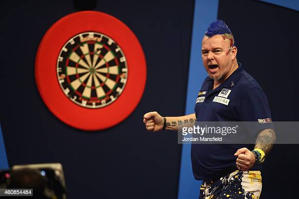 Peter Wright of Scotland celebrates winning a leg in his second round match against Ronny Huybrechts of Belgium during Day Seven of the William Hill...