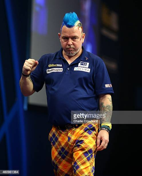Peter Wright of Scotland celebrates winning a set during his quarter final match against Gary Anderson of Scotland during the William Hill PDC World...