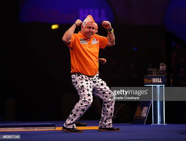 Peter Wright of Scotland celebrates winning his third round match against Andy Hamilton of England during the William Hill PDC World Darts...