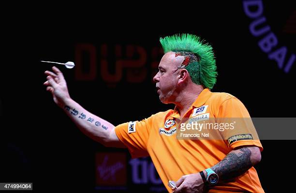 Peter Wright of Scotland competes aginst Phil Taylor of England during the 2015 Dubai Duty Free Darts Masters QuarterFinal match at Dubai Duty Free...