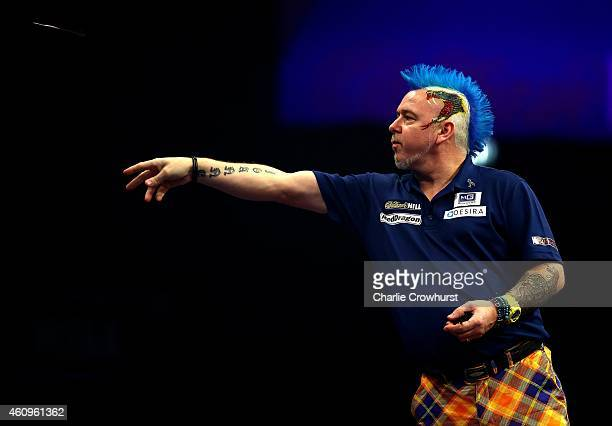 Peter Wright of Scotland in action during his quarter final match against Gary Anderson of Scotland during the William Hill PDC World Darts...