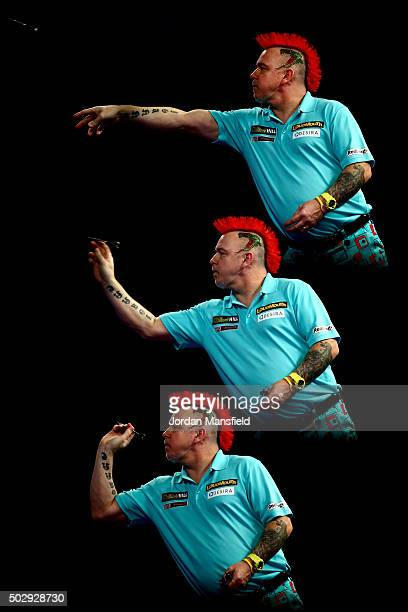 Peter Wright of Scotland in action during his third round match against Dave Chisnall of England on Day Twelve of the 2016 William Hill PDC World...